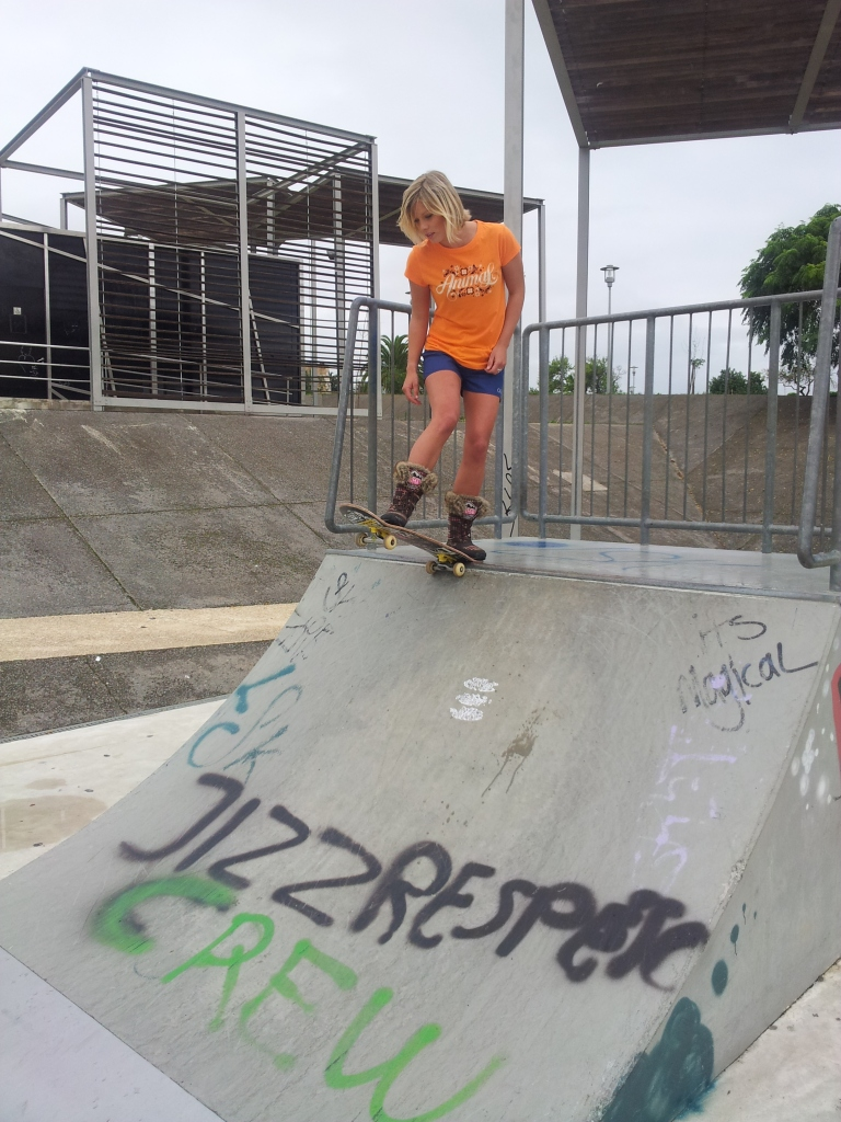Surfer Hannah Harding tries skateboarding...she made it haha :)